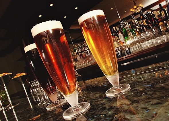 Three Frosted Beer Glasses on Granite Counter