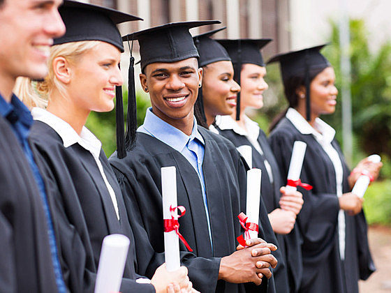 happy multiracial university students graduation